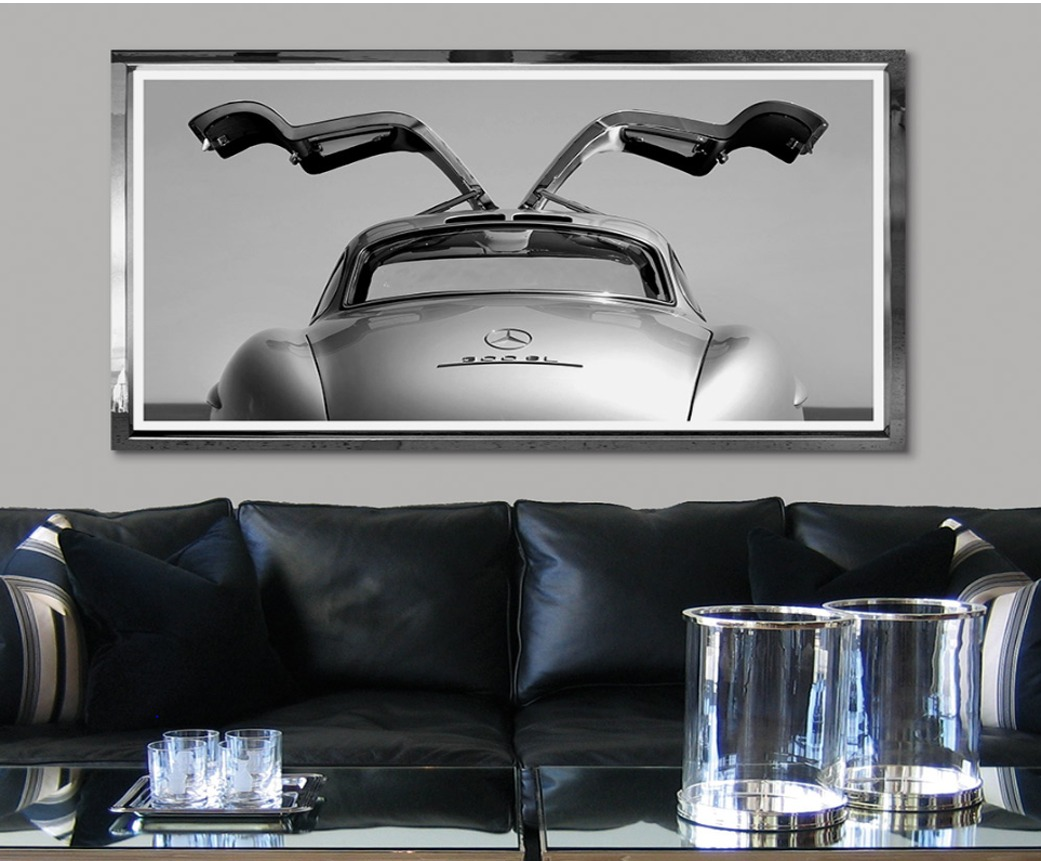 Mercedes Oldtimer wallart with black leather couch seating area - Original Interiors