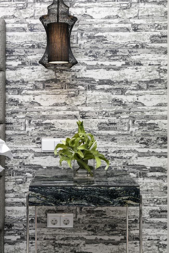 Printed wall covering with black fabric hanging wall and green flowers - Original Interiors