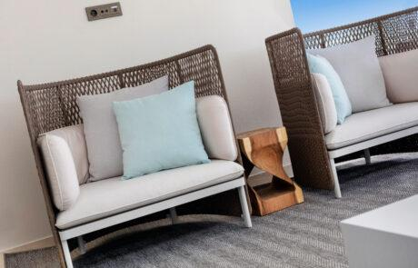 Rope chairs brown white blue grey pillows- Original Interiors