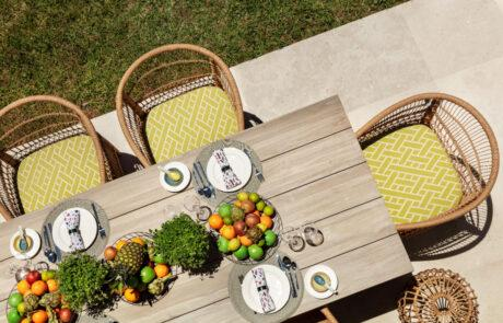 Bamboo table with bamboo yellow charis and fruit - Original Interiors