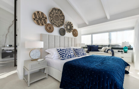 Whitemaster bedroom with marble bathroom velvet blue bed - Original Interiors