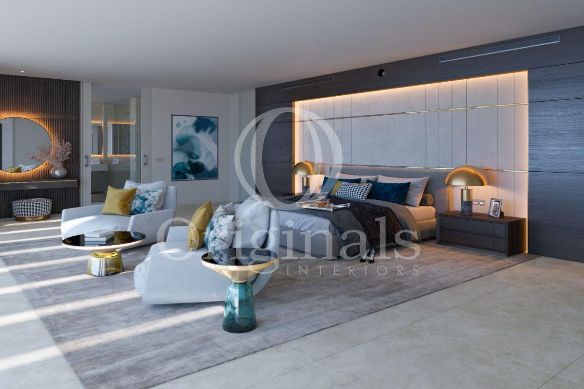Bedroom with grey chairs and a dark background with back lighting - Originals Interiors