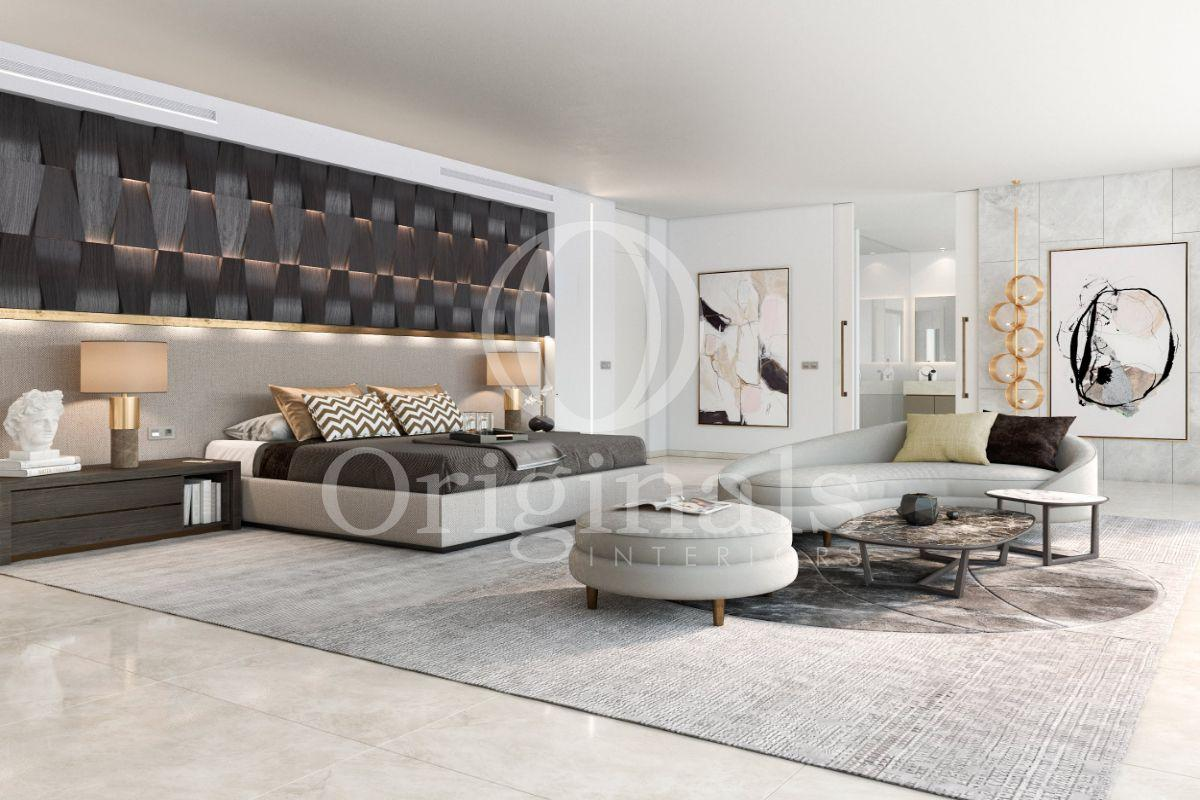 Large bedroom with black background, white walls, a hard white floor and grey furniture - Originals Interiors