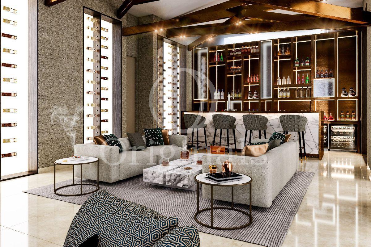 Lounge area with large wine racks, grey sofa´s and a luxurious bar - Originals Interiors