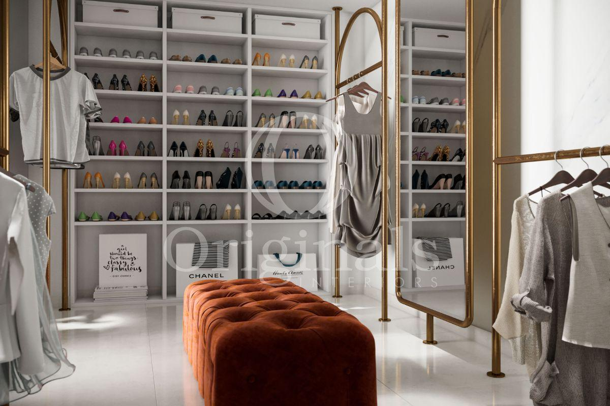 Walk in closet with golden racks and a large shoe closet - Originals Interiors