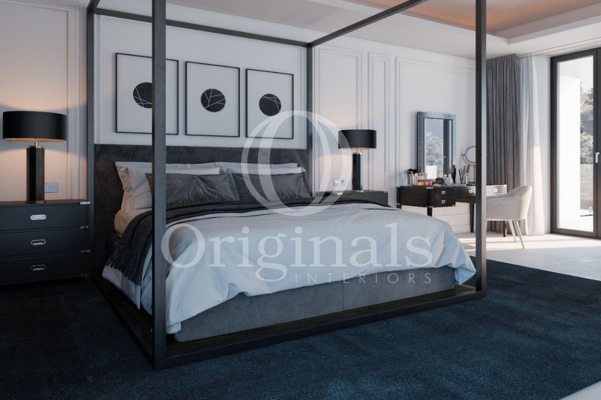 Bedroom with a dark blue carpet - Originals Interiors
