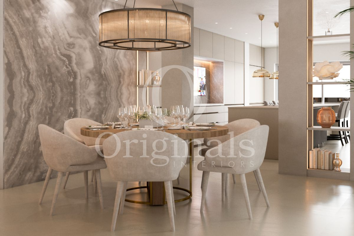 Dining area with wooden table, large hanging lamp, white chairs and a marble background - Originals Interiors