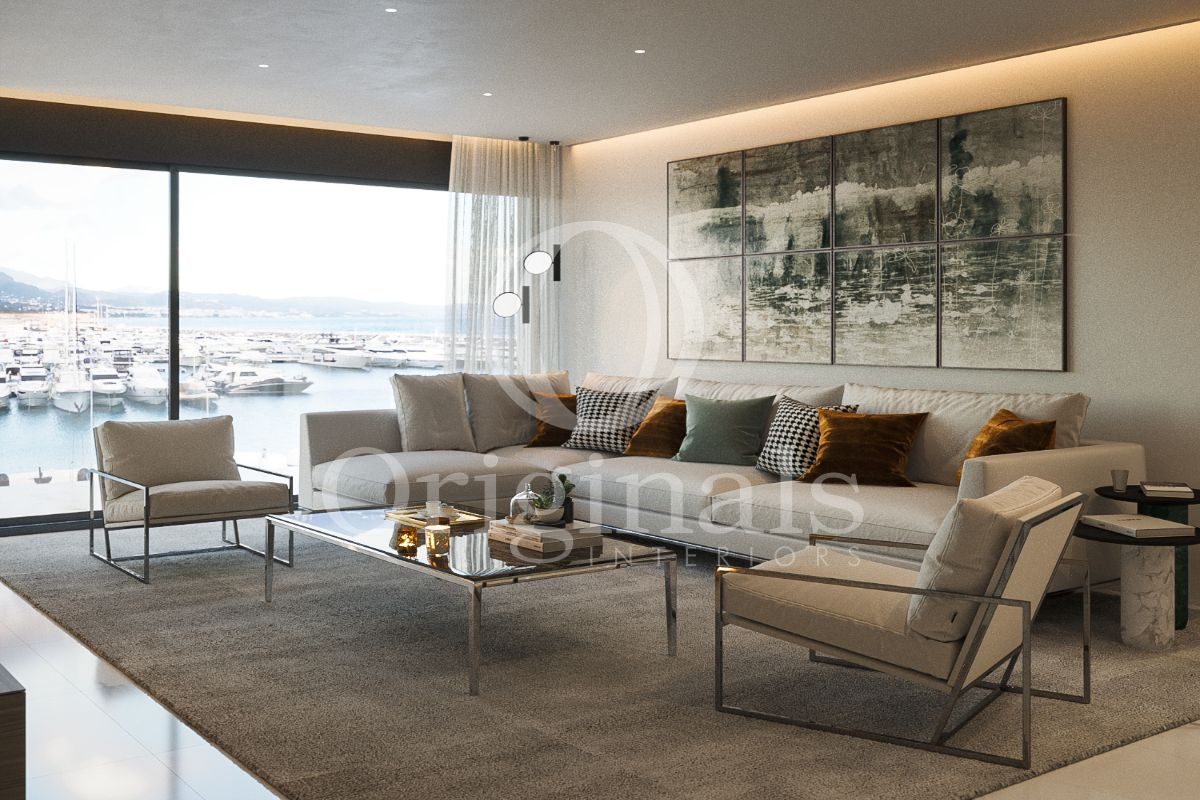 Living room with large artistic artwork, a large grey sofa, a glass coffee tables and a large window - Originals Interiors