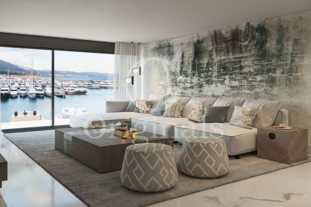 Living room with artistic wall art, a large white sofa, a luxurious wooden coffee table, a grey carpet and designer poufs - Originals Interirors