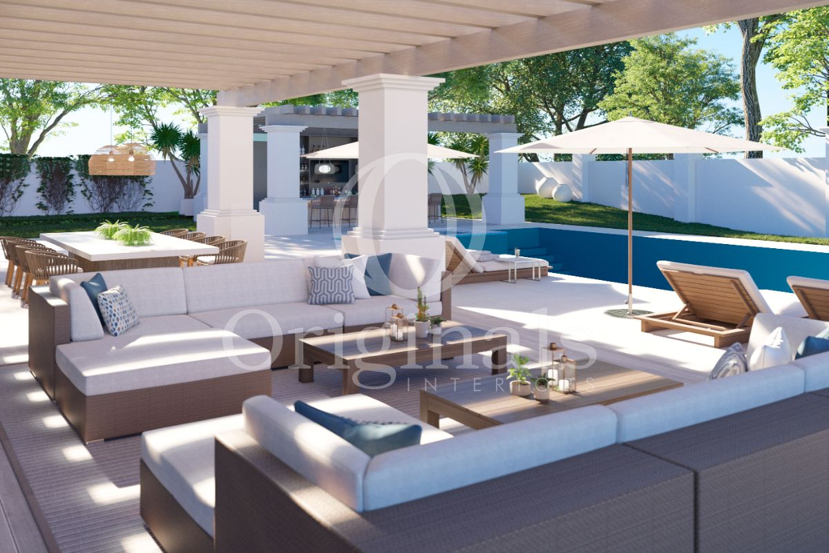 Outside lounge area with a grey sofa with white cushions, wooden coffee tables, wooden lounge chairs and a large dining table - Originals Interiors