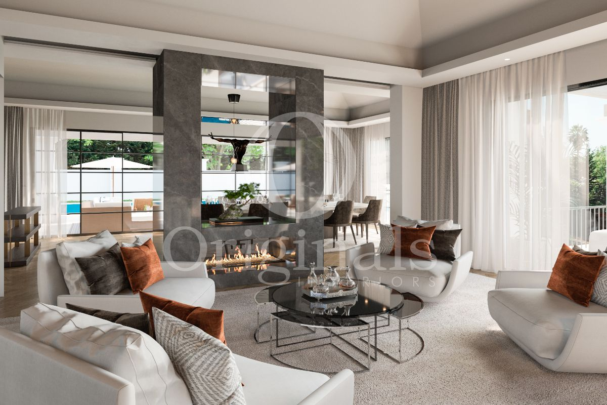 Lounge area with white sofas, a large grey marble fire pit, white curtains and a large window - Originals Interiors
