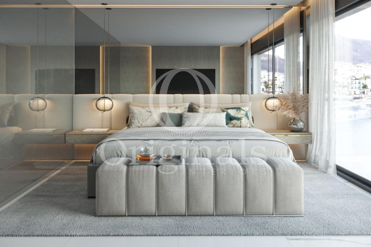 Bedroom with large mirror wall, grey carpet, white curtains and a large window - Originals interiors
