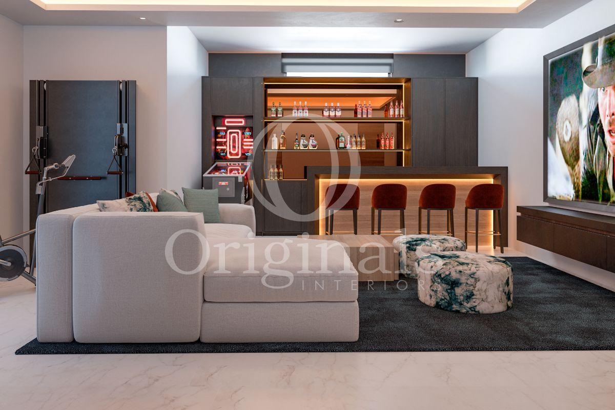A lounge area with a grey sofa and a bar with red bar chairs - Originals Interiors