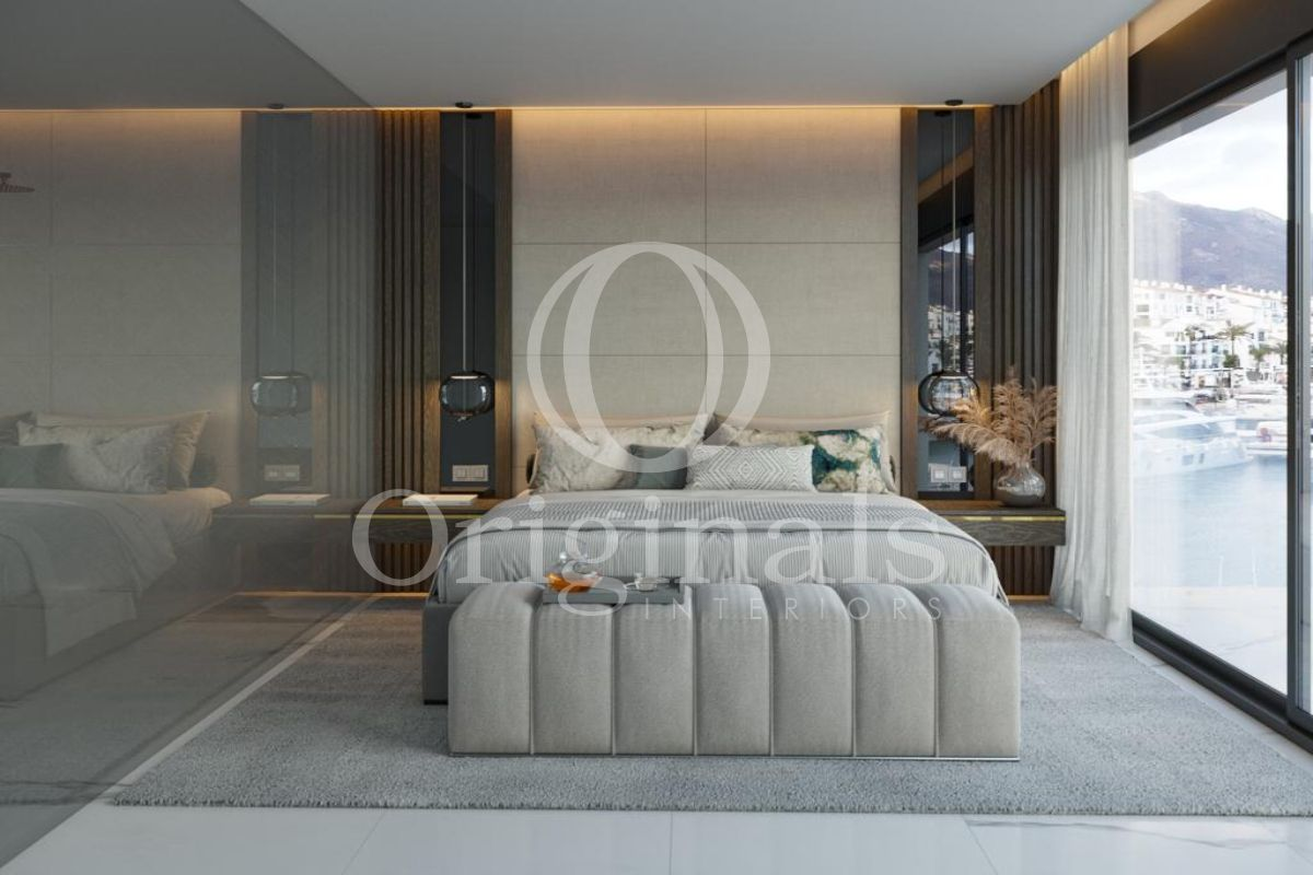 Bedroom with grey carpet, wooden shelves, brown and white curtains and a large window - Originals Interiors