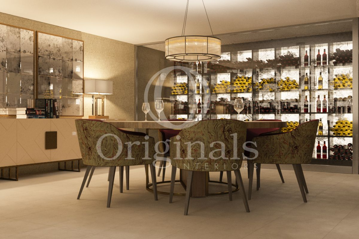 Dining area with green chairs, a wooden table and a large wine holder - Originals Interiors
