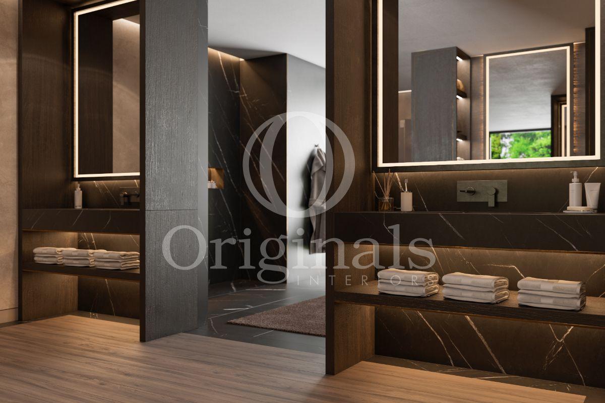 Bathroom with dark wood and dark marble and a wooden floor - Originals Interiors