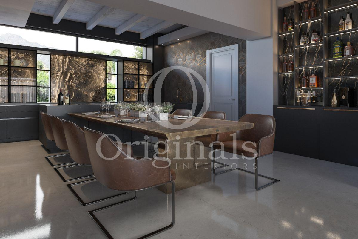 A dining area with a wooden table and brown chairs. A bar is included - Originals Interiors