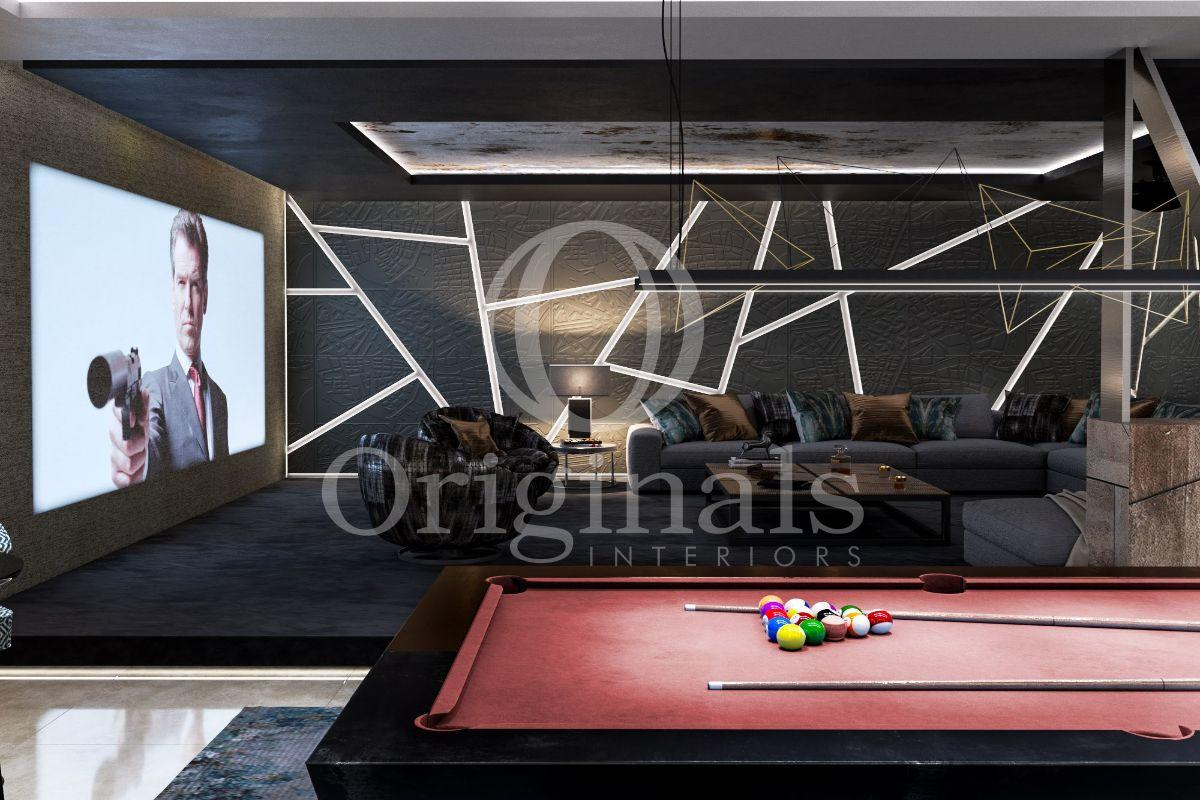A home cinema with large dark sofa´s and artistic lighting, A pool table is included - Originals Interiors