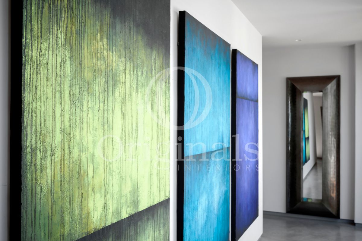 Green and Blue artworks in a hallway - Original Interiors