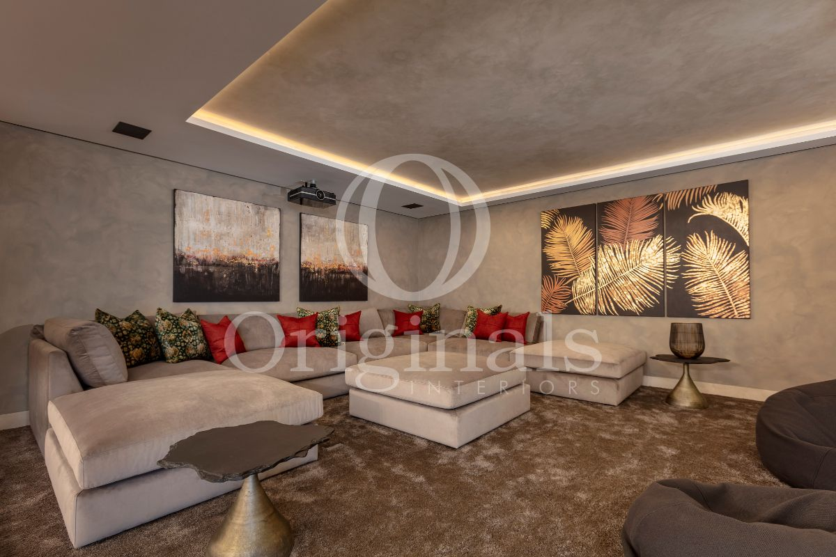 Luxury living room with grey walls and sofa and artworks on the wall - Originals Interiors