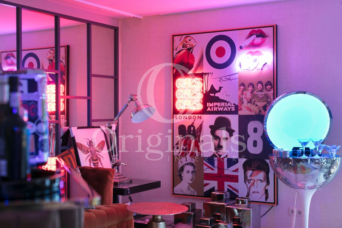 Photographic artwork on the wall with pink lighting - Originals Interiors