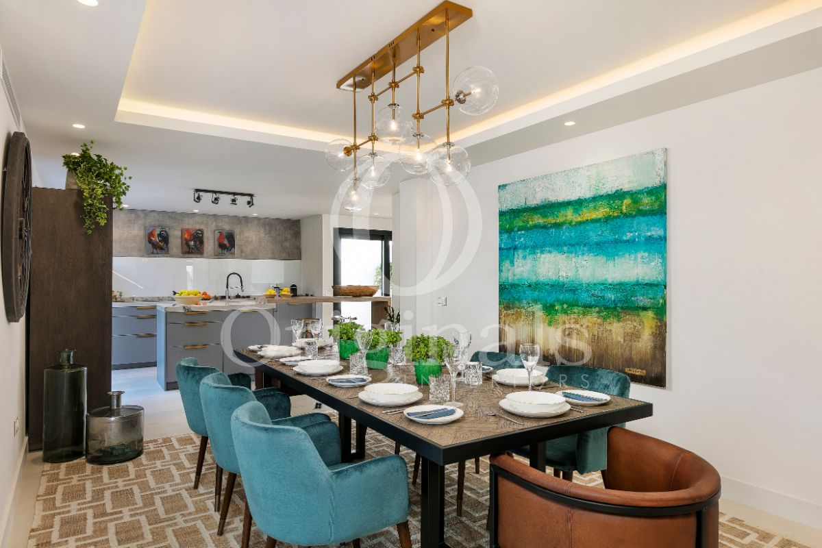 Luxury dining area with blue chairs and a blue artwork on the wall - Originals interiors