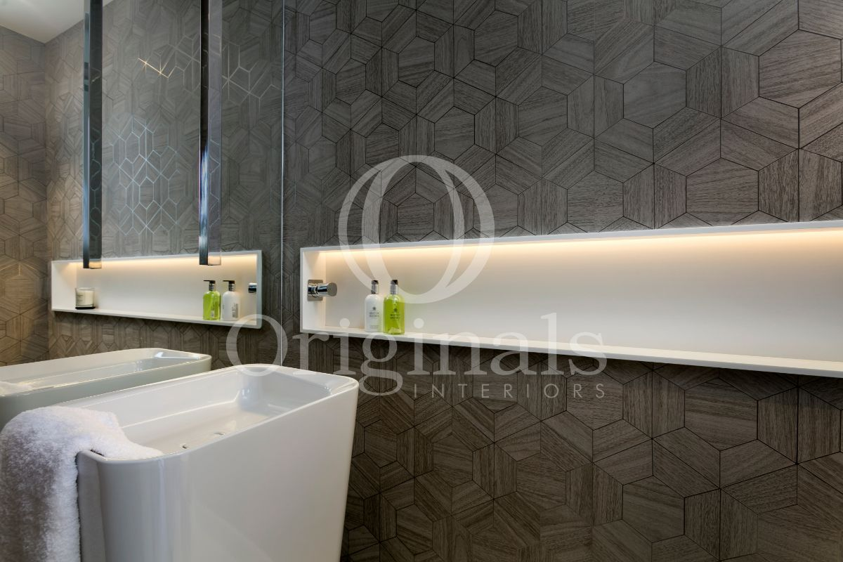 Luxury bathroom with backlighting and grey background - Originals Interiors
