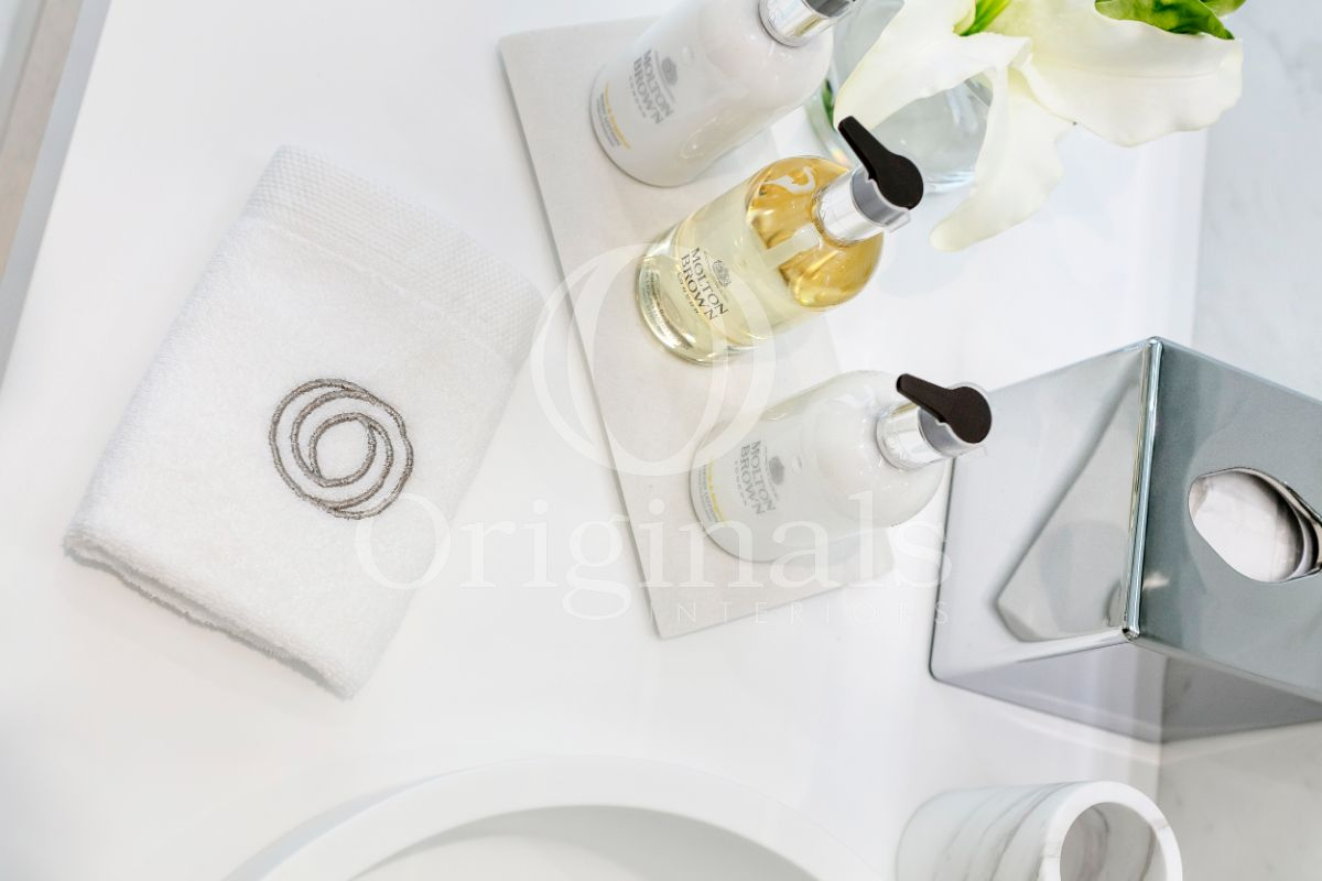 White shelf for stalling bathroom accessories - Originals Interiors