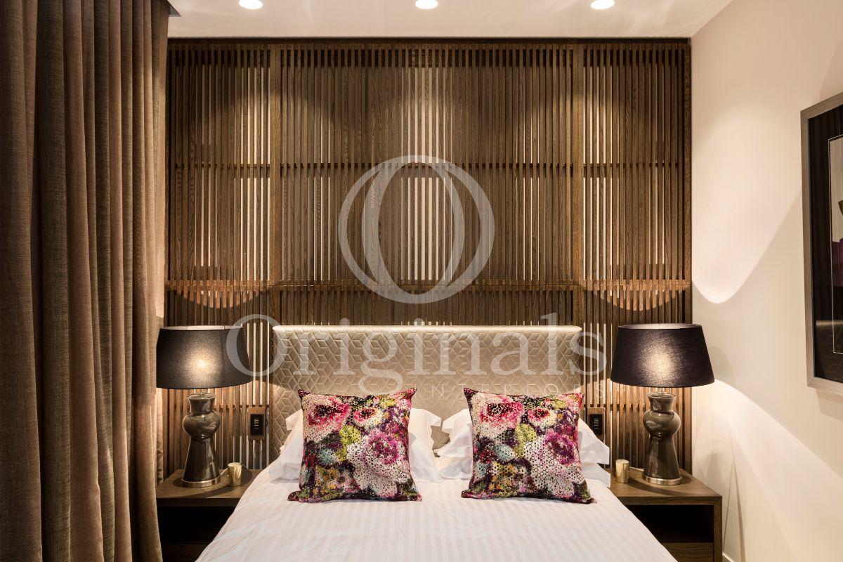 Bedroom with grey lamps and wooden background - Originals Interiors