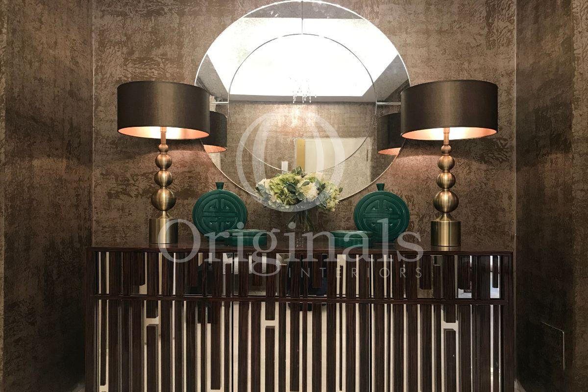 Mirror hanging on dark brown steel wall - Originals Interiors