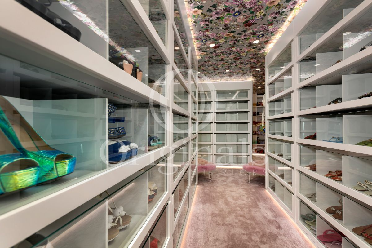 Large walk-in shoe cabinet with pink carpet and a flower ceiling - Originals Interiors