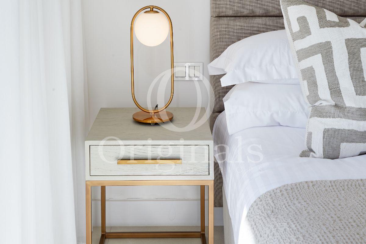 Golden lamp on little cupboard - Originals interiors