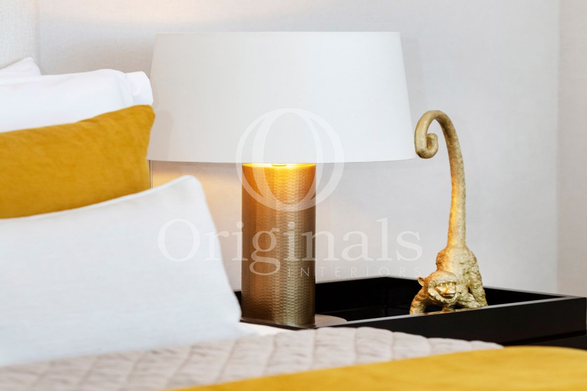 White Lamp with Golden accents and accessories on black cupboard - Originals Interiors