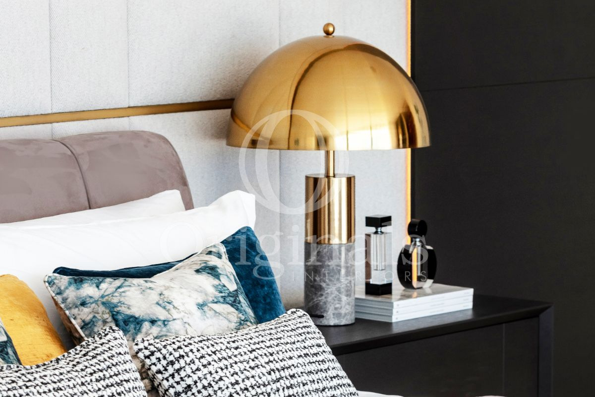 Golden Lamp with marble accents on black shelf - Originals Interiors