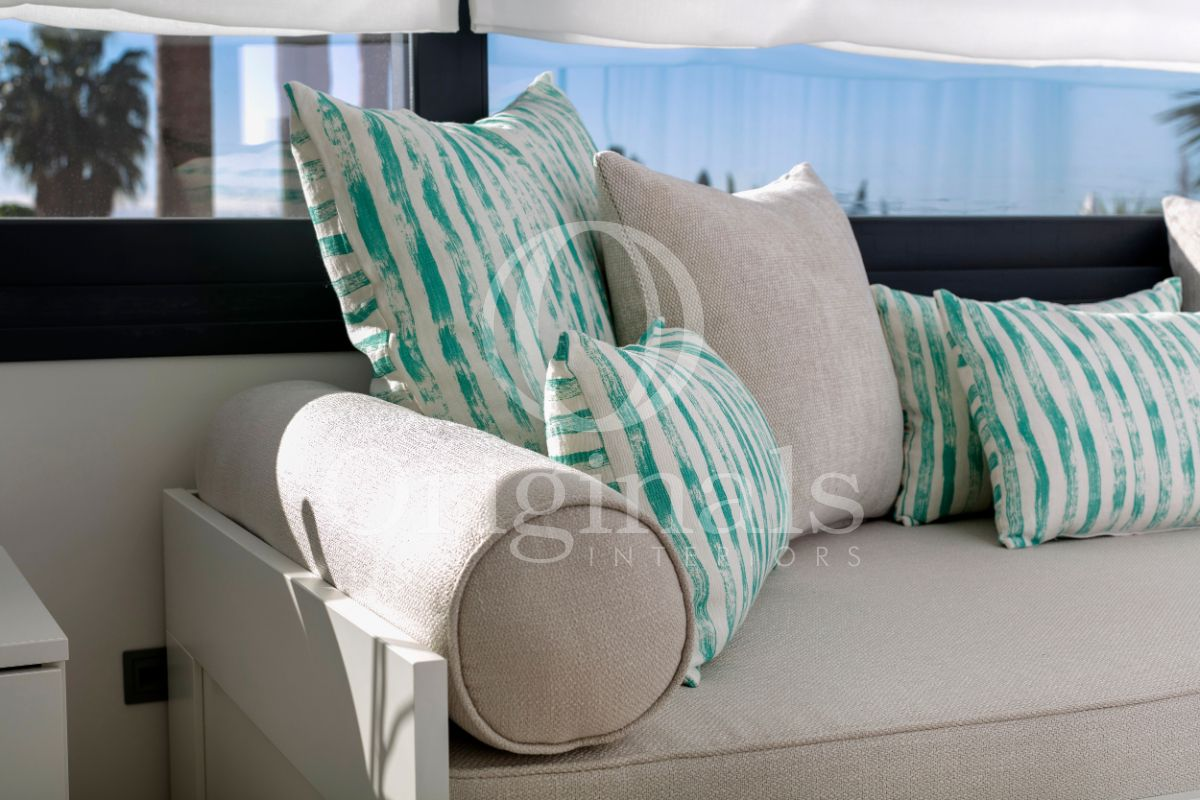 White pillows with blue accents on a grey sofa - Original Interiors
