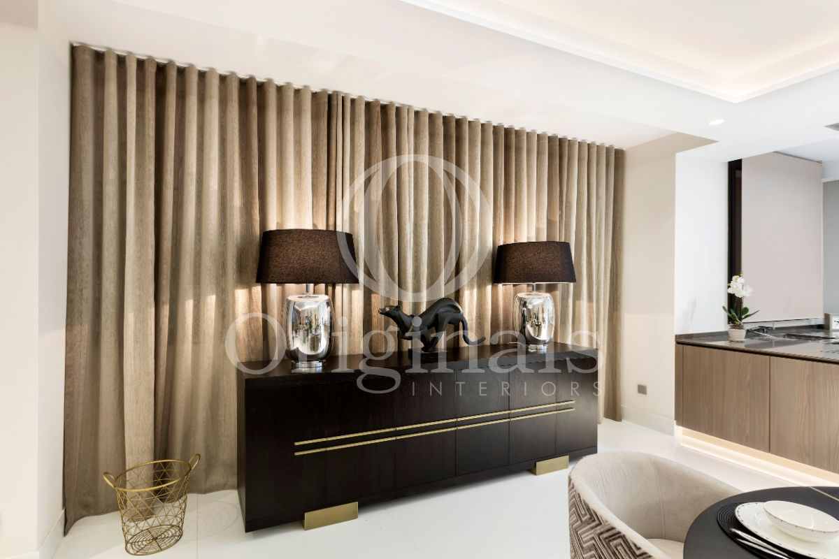 Luxury black shelf with golden accents and luxury lamps - Originals Interiors
