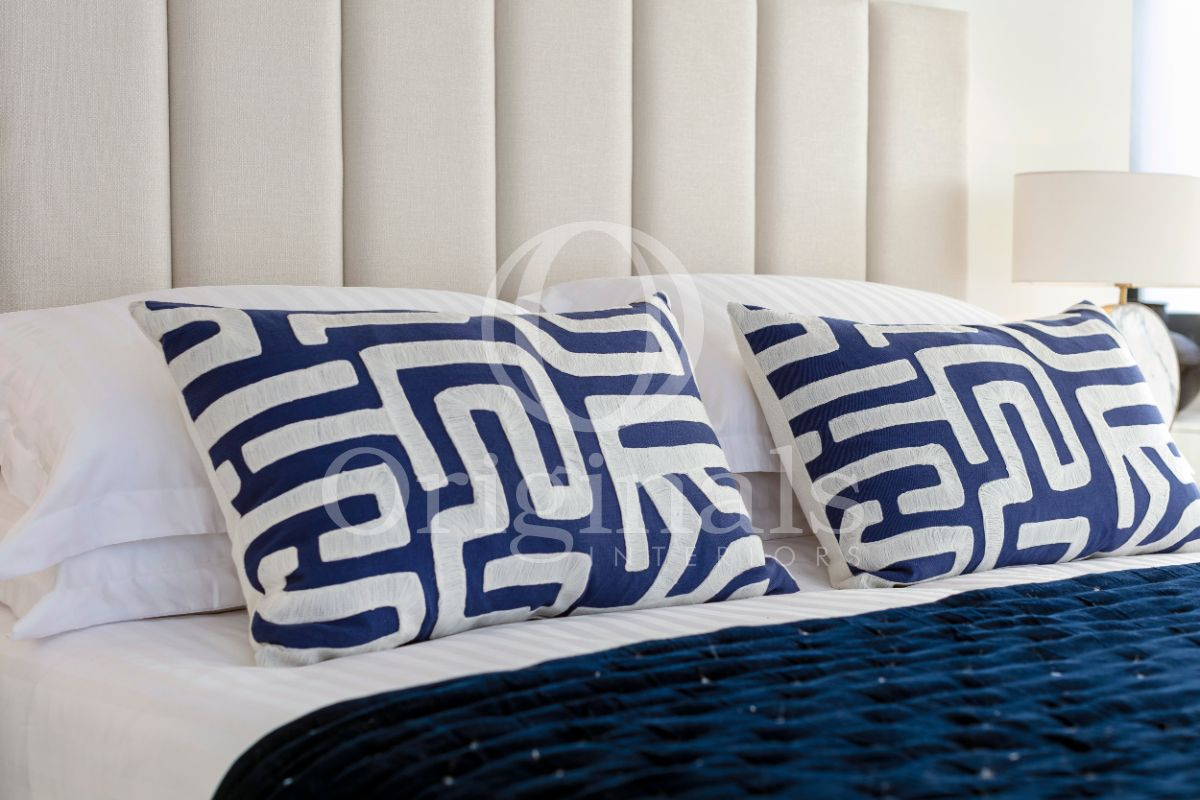 White pillows with blue patterns - Originals Interiors