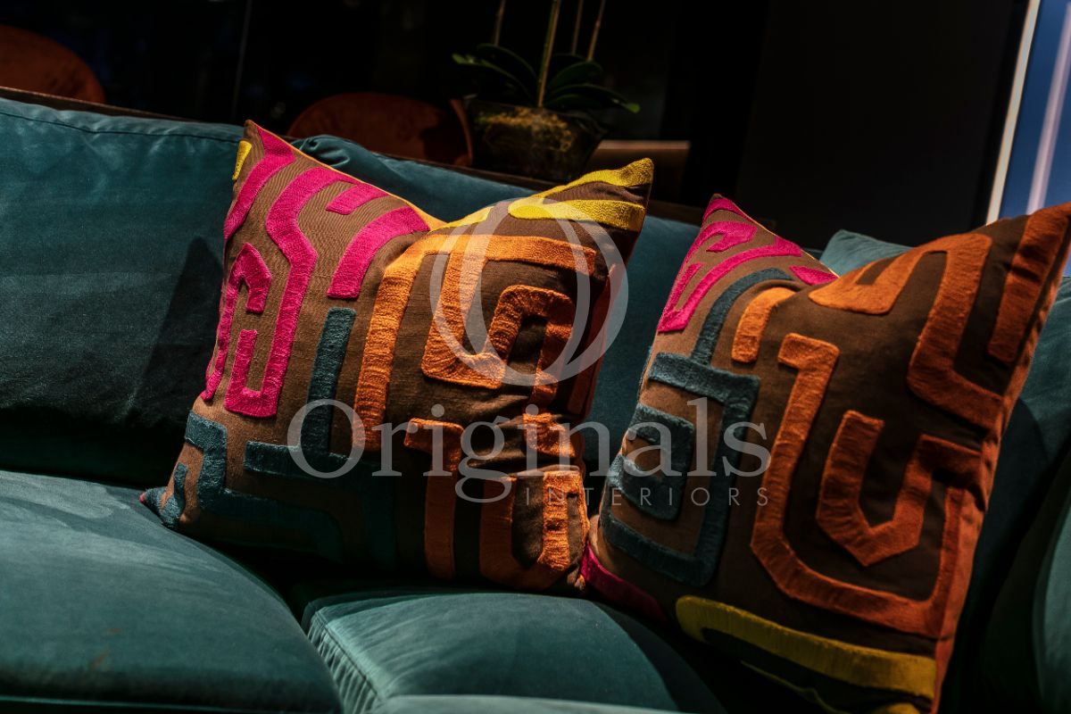 Torquoise sofa with brown pillows - Originals Interiors